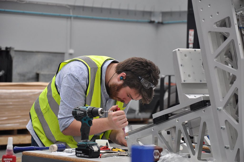 A picture of an engineer building a frame