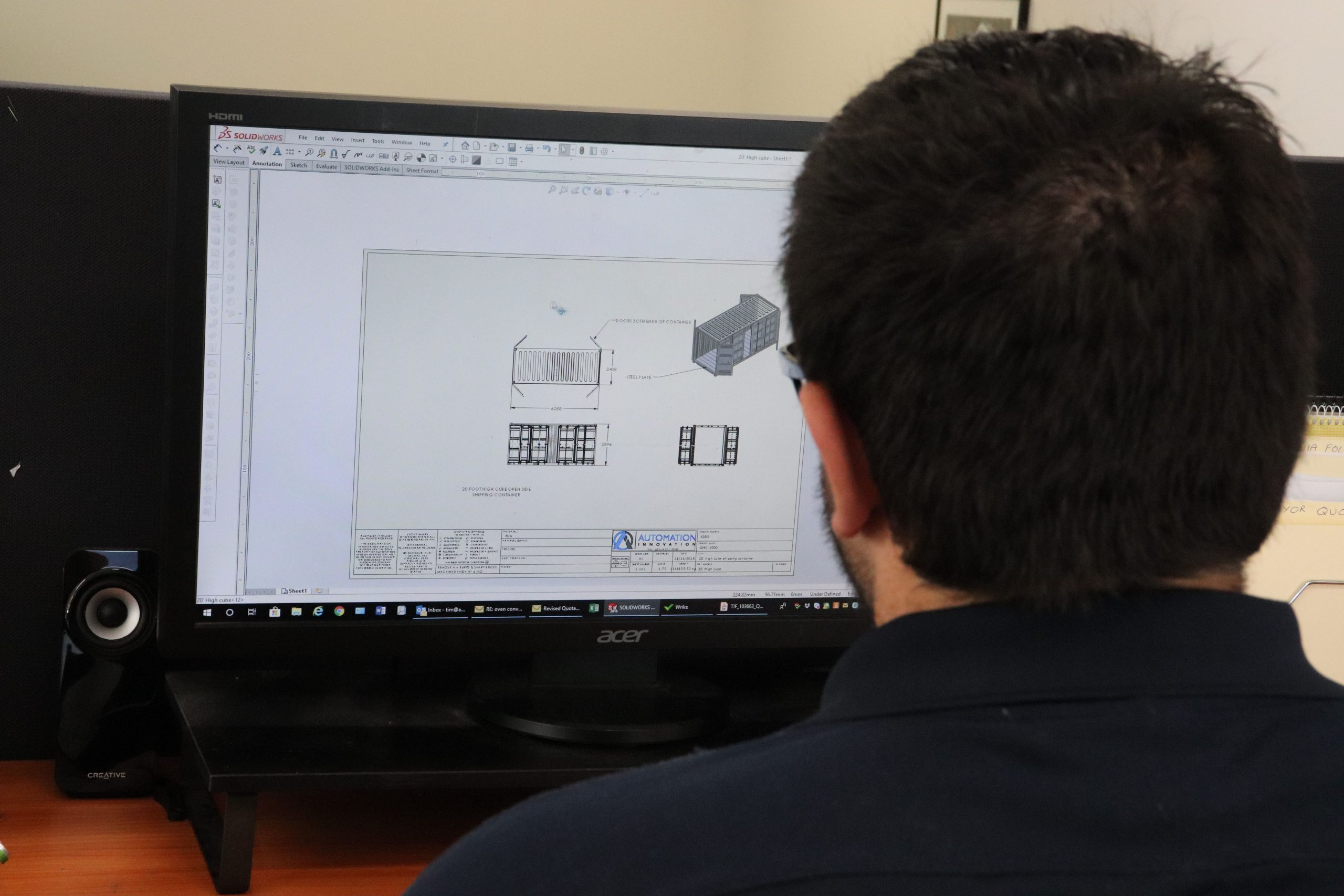 A picture of an Engineer using CAD program